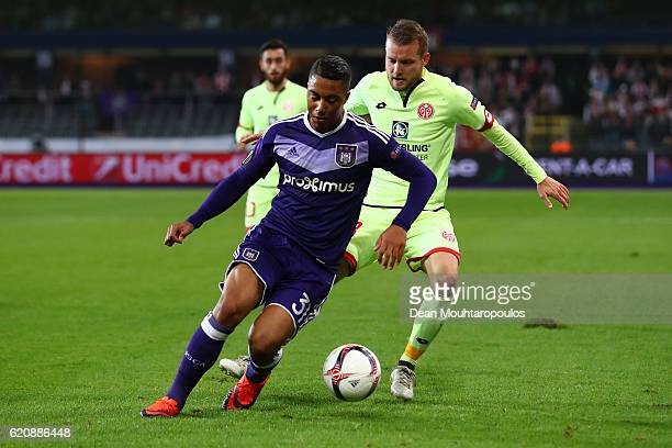 Youri Tielemans of RSC Anderlecht shields the ball from Daniel Brosinski of 1 FSV Mainz 05 during the UEFA Europa League Group C match between RSC...