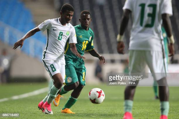 Yousef Alharbi of Saudi Arabia and Ousseynou Niang of Senegal compete for the ball during the FIFA U20 World Cup Korea Republic 2017 group F match...