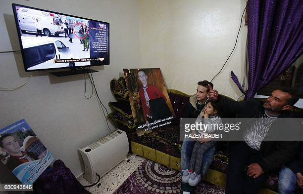 Yousri the father of Abdul Fatah alSharif watches on television the verdict of the trial of Israeli soldier Elor Azaria who killed their son at their...