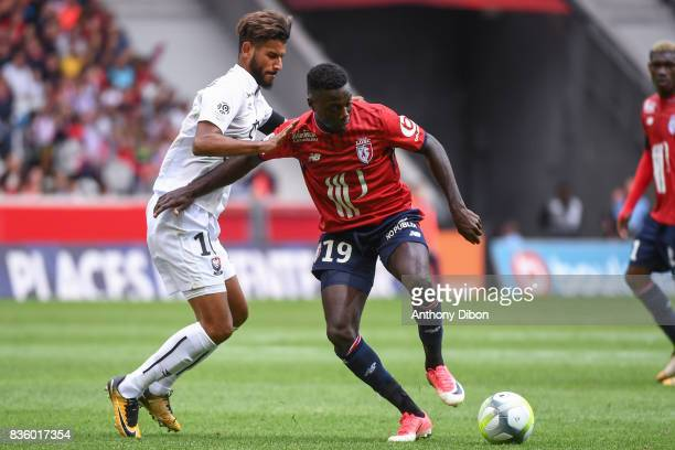 Youssef Ait Bennasser of Caen and Nicolas Pepe of Lille during the Ligue 1 match between Lille OSC and SM Caen at Stade Pierre Mauroy on August 20...