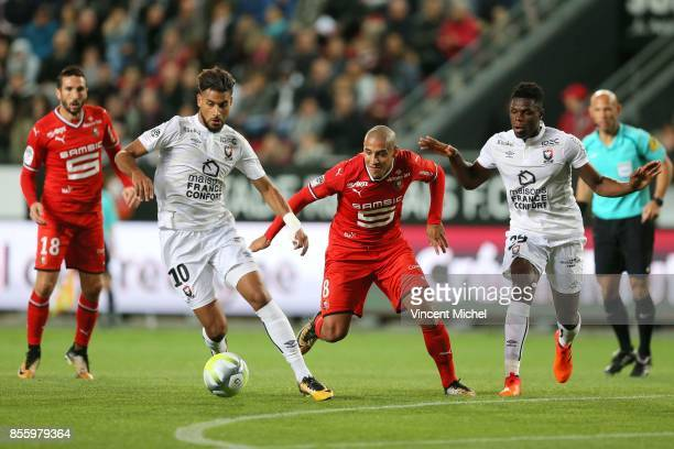 Youssef Ait Benasser of Caen and Wahbi Khazri of Rennes during the Ligue 1 match between Stade Rennais and SM Caen at Roazhon Park on September 30...