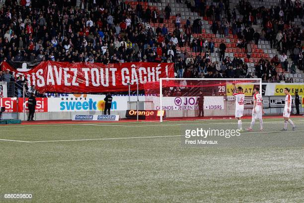 Youssef Ait Bennasser of Nancy and Erick Cabaco Almada of Nancy and Joffrey Cuffaut of Nancy look dejected at the end of the game with fans of Nancy...