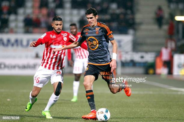 Youssef Ait Bennasser of Nancy and Francois Bellugou of Lorient during the French League match between Nancy and Lorient at Stade Marcel Picot on...
