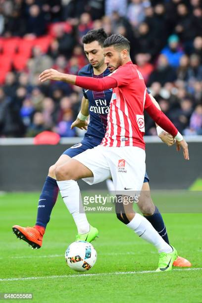 Youssef Ait Bennasser of Nancy and Javier Pastore of PSG during the French Ligue 1 match between Paris Saint Germain and Nancy at Parc des Princes on...