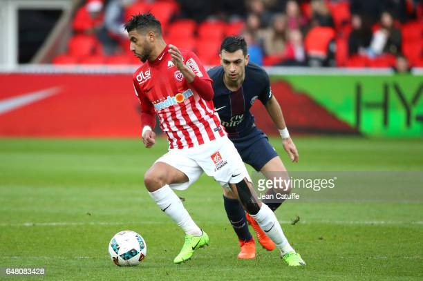 Youssef Ait Bennasser of Nancy and Javier Pastore of PSG in action during the French Ligue 1 match between Paris Saint Germain and AS Nancy Lorraine...