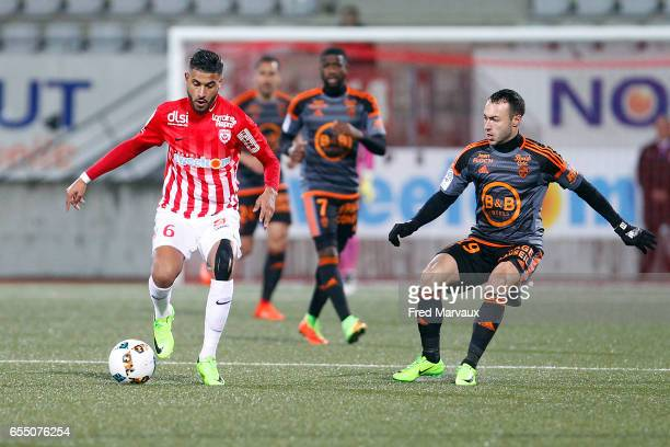 Youssef Ait Bennasser of Nancy and Romain Philippoteaux of Lorient during the French League match between Nancy and Lorient at Stade Marcel Picot on...