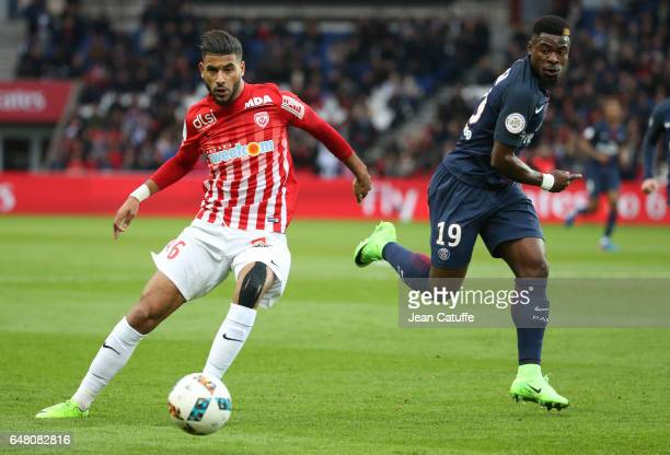 Youssef Ait Bennasser of Nancy and Serge Aurier of PSG in action during the French Ligue 1 match between Paris Saint Germain and AS Nancy Lorraine at...