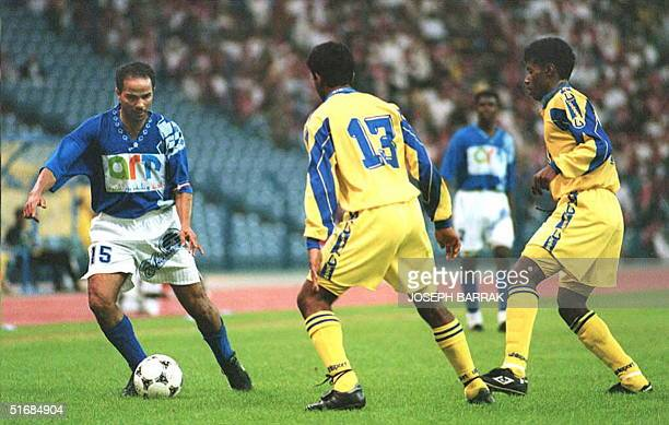 Youssef AlThanayan from AlHilal tries to overtake Ibrahim ElChoueia and khaled AlFarhan from AlNasr Hilal went to the final of the Arab Club...