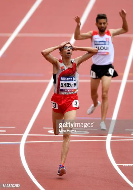 Youssef Benibrahim of Morocco celebrates as he crosses the line to win the Men's 5000m T13 Final ahead of Bilel Aloui of Tunisia during day three of...