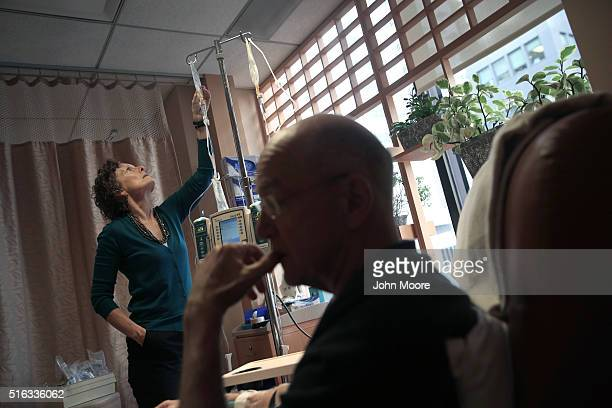 Youssef Cohen undergoes cancer treatment as his wife Lindsay Wright checks his medication drip on March 17 2016 in New York City Cohen has an...