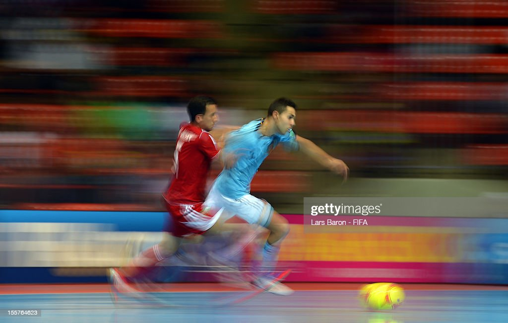 Youssef El Mazray of Morocco challenges Alcardo of Spain during the FIFA Futsal World Cup Group B match between Morocco and Spain at Indoor Stadium Huamark on November 8, 2012 in Bangkok, Thailand.