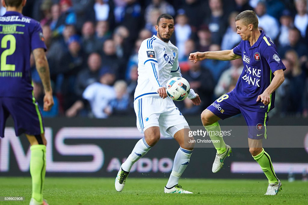 Youssef Toutouh of FC Copenhagen and Andr�� Romer of FC Midtjylland compete for the ball during the Danish Alka Superliga match between FC Copenhagen and FC Midtjylland at Telia Parken Stadium on May 01, 2016 in Copenhagen, Denmark.