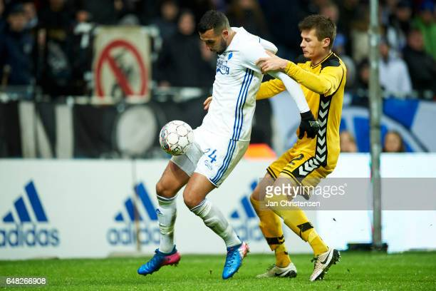 Youssef Toutouh of FC Copenhagen and Elfar Freyr Helgason of AC Horsens compete for the ball during the Danish Alka Superliga match between FC...