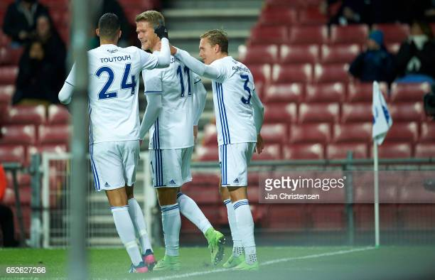 Youssef Toutouh of FC Copenhagen Andreas Cornelius of FC Copenhagen and Ludwig Augustinsson of FC Copenhagen celebrate after the 20 goal from Andreas...