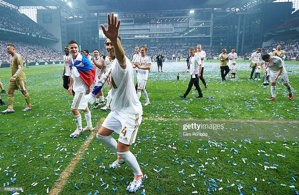 Youssef Toutouh of FC Copenhagen applaus the fans and celebrates as Danish Champions 2015/2016 after the Danish Alka Superliga match between FC Copenhagen and AGF Aarhus at Telia Parken Stadium on May 29, 2016 in Copenhagen, Denmark.