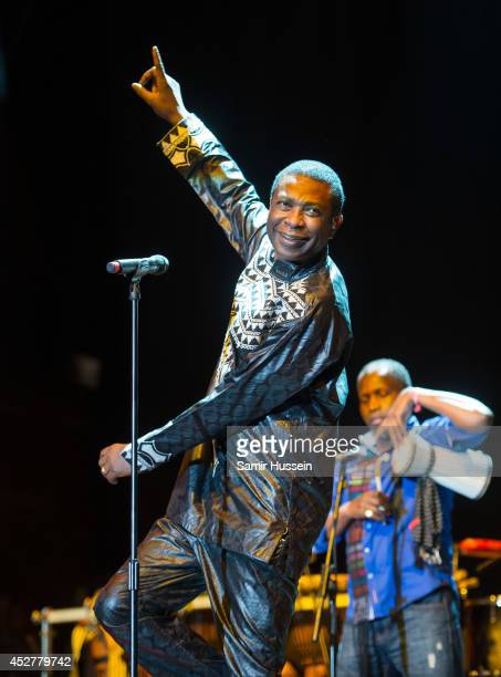 Youssou N'Dour performs on the Open Air stage as he headlines Womad at Charlton Park on July 26 2014 in Wiltshire United Kingdom