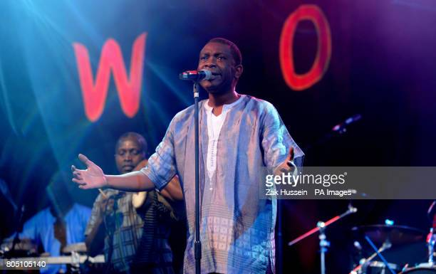 Youssou Ndour performs on the Open Air Stage during the Womad Festival at Charlton Park Wiltshire