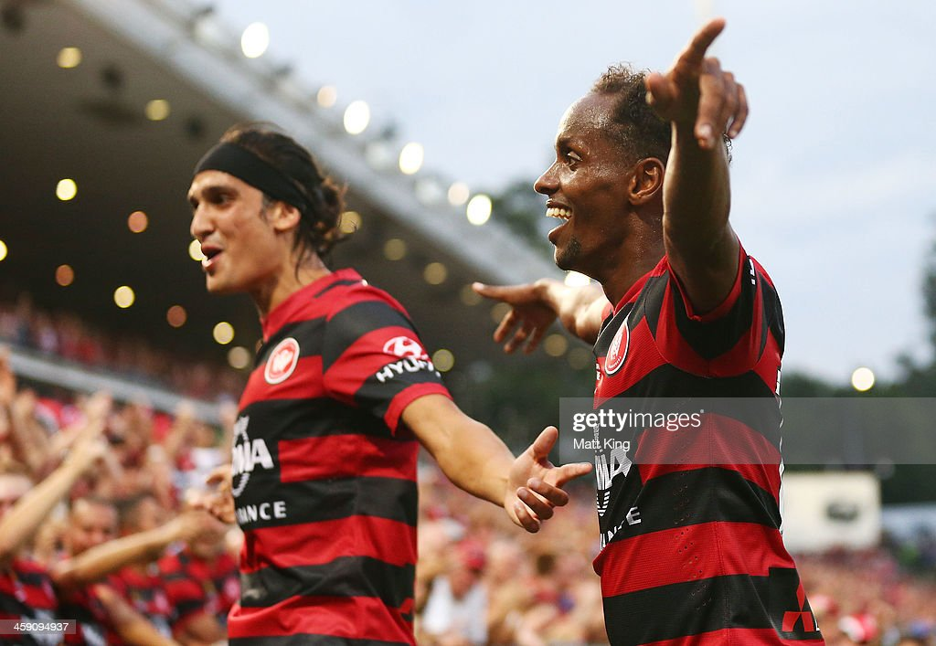 Youssouf Hersi (R) of the Wanderers celebrates with <a gi-track='captionPersonalityLinkClicked' href=/galleries/search?phrase=Jerome+Polenz&family=editorial&specificpeople=790750 ng-click='$event.stopPropagation()'>Jerome Polenz</a> after scoring the second goal during the round 11 A-League match between the Western Sydney Wanderers and the Central Coast Mariners at Parramatta Stadium on December 23, 2013 in Sydney, Australia.