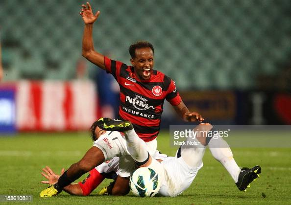 Youssouf Hersi of the Wanderers is tackled by Jeronimo Neumann of Adelaide during the round 12 ALeague match between the Western Sydney Wanderers and...