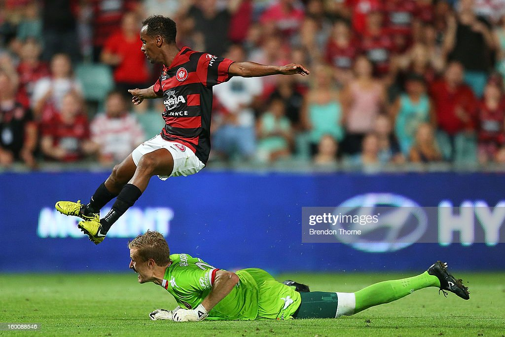 Youssouf Hersi of the Wanderers leaps Andrew Redmayne of the Heart during the round 18 A-League match between the Western Sydney Wanderers and the Melbourne Heart at Parramatta Stadium on January 26, 2013 in Sydney, Australia.