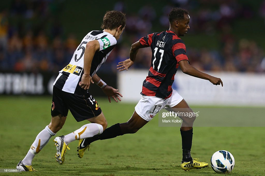 Youssouf Hersi of the Wanderers runs the ball during the round 20 A-League match between the Western Sydney Wanderers and the Newcastle Jets at Campbelltown Sports Stadium on February 9, 2013 in Sydney, Australia.