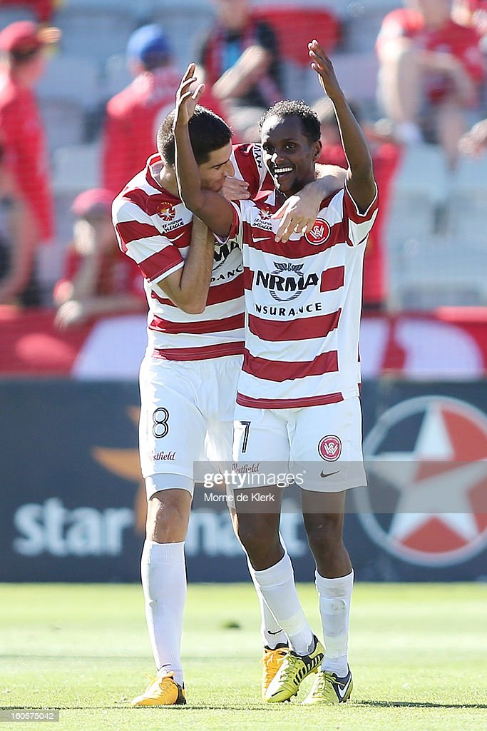 Youssouf Hersi (R) of Western Sydney celebrates after scoring a goal during the round 19 A-League match between Adelaide United and the Western Sydney Wanderers at Hindmarsh Stadium on February 3, 2013 in Adelaide, Australia.