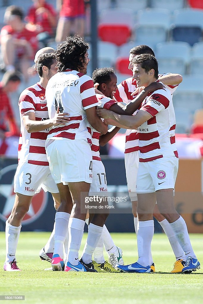 Youssouf Hersi (C) of Western Sydney is congratulated after he scored a goal during the round 19 A-League match between Adelaide United and the Western Sydney Wanderers at Hindmarsh Stadium on February 3, 2013 in Adelaide, Australia.
