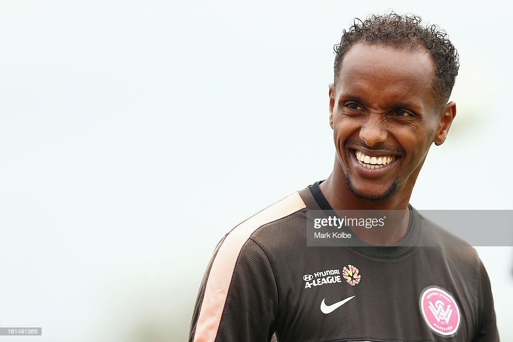 Youssouf Hersi shares a laugh with a team mate during a Western Sydney Wanderers A-League training session at Blacktown International Sportspark on February 12, 2013 in Sydney, Australia.