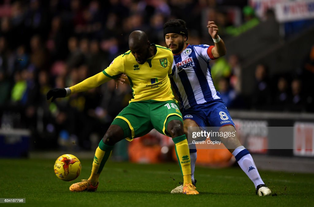 Youssouf Mulumbu of Norwich is tackled by Sam Morsy of Wigan during the Sky Bet Championship match between Wigan Athletic and Norwich City at DW Stadium on February 7, 2017 in Wigan, England.