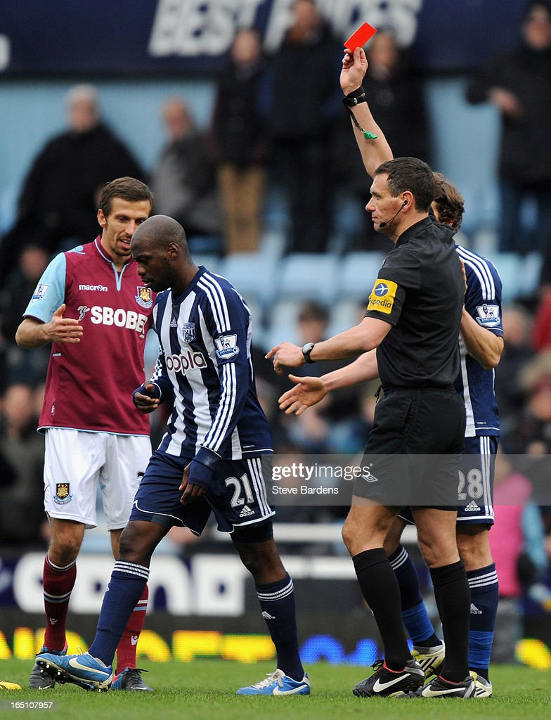 Youssouf Mulumbu of West Bromwich Albion is sent off by referee <a gi-track='captionPersonalityLinkClicked' href=/galleries/search?phrase=Andre+Marriner&family=editorial&specificpeople=221003 ng-click='$event.stopPropagation()'>Andre Marriner</a> during the Barclays Premier League match between West Ham United and West Bromwich Albion at the Boleyn Ground on March 30, 2013 in London, England.
