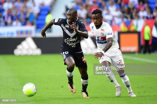 Youssouf Sabaly of Bordeaux and Maxwell Cornet of Lyon during the Ligue 1 match between Olympique Lyonnais and FC Girondins de Bordeaux at Groupama...