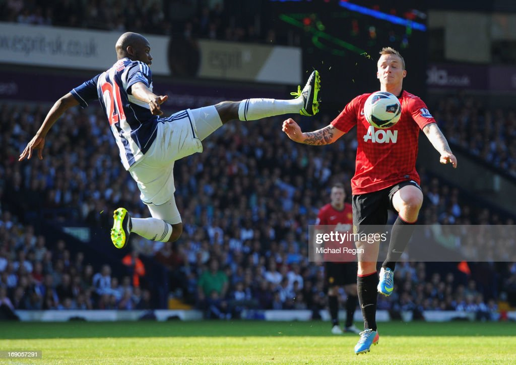 Youssuf Mulumbu of West Bromwich Albion battles with Alexander Buttner of Manchester United during the Barclays Premier League match between West Bromwich Albion and Manchester United at The Hawthorns on May 19, 2013 in West Bromwich, England.