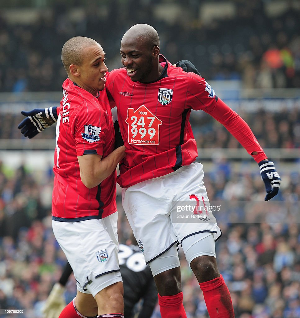 Youssuf Mulumbu of West Bromich Albion is congratulated by team-mate <a gi-track='captionPersonalityLinkClicked' href=/galleries/search?phrase=Peter+Odemwingie&family=editorial&specificpeople=648594 ng-click='$event.stopPropagation()'>Peter Odemwingie</a> after scoring during the Barclays Premier League match between Birmingham City and West Bromwich Albion on March 5, 2011 in Birmingham, England.