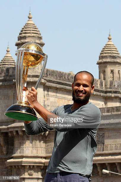 Yousuf Pathan of the Indian cricket team poses with the ICC Cricket World Cup Trophy with the Gateway of India in the backdrop during a photo call at...