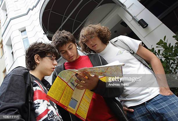 Youth backpackers of Spain study a map outside the Circus hostel Berlin on July 19 2010 in Berlin Germany Millions of youth people taking a gap year...