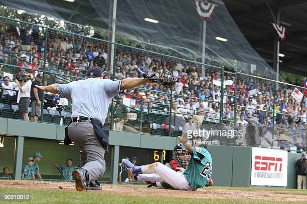Little League World Series Asia Pacific Kuan Sheng Huang in action home plate slide vs Mexico Luis Trevino during International Championship at...