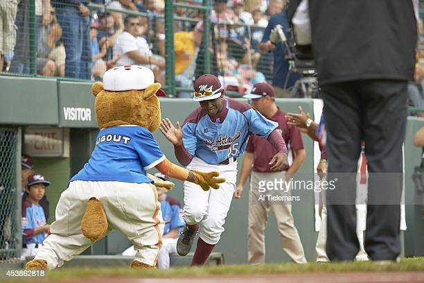 Little League World Series MidAtlantic Region Team Zion Spearman of Taney Youth Association from Philadelphia with teammates and Little League mascot...