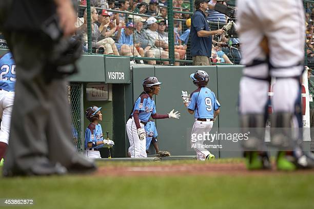 Little League World Series MidAtlantic Region Team Mo'ne Davis greets teammate Carter Davis of Taney Youth Association from Philadelphia from dugout...