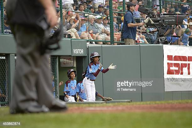Little League World Series MidAtlantic Region Team Mo'ne Davis of Taney Youth Association from Philadelphia cheers for teammates from dugout during...