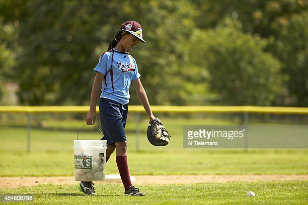 Little League World Series MidAtlantic Region Team Mo'ne Davis of Taney Youth Association from Philadelphia carrying a bucket of balls in the infield...