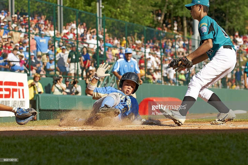 US Team West (Parkview LL of Chula Vista, CA) Nick Conlin (8) in action, scoring game tying run on wild pitch vs Asia Pacific (Kuei-Shan LL of Taoyuan, Chinese Taipei) Hung Yuan Lin (14) during 4th inning of Championship Game at Howard J. Lamade Stadium. Williamsport, PA 8/30/2009