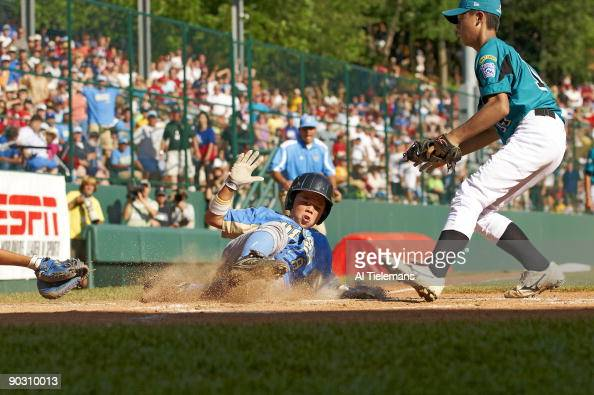 Little League World Series US Team West Nick Conlin in action scoring game tying run on wild pitch vs Asia Pacific Hung Yuan Lin during 4th inning of...