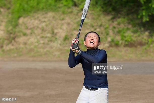 youth baseball players doing swing training