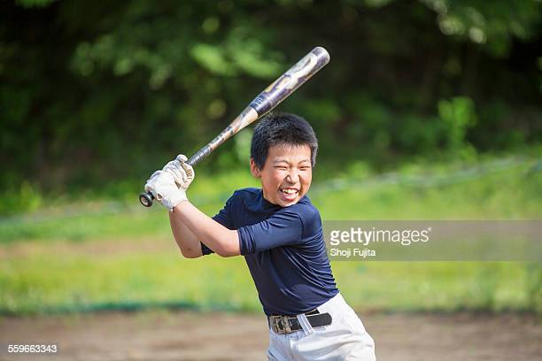 youth baseball players doing swing training