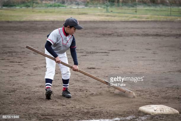 Youth Baseball Players, groundskeeper