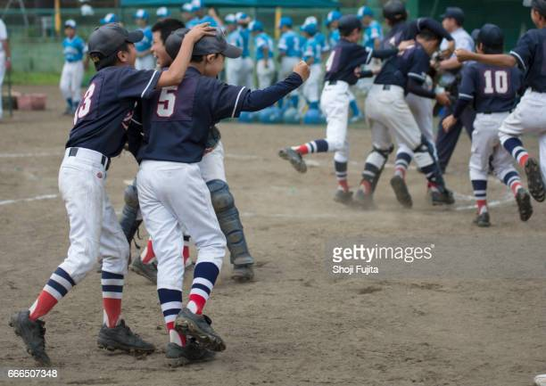 Youth Baseball Players, Teammates,win the game
