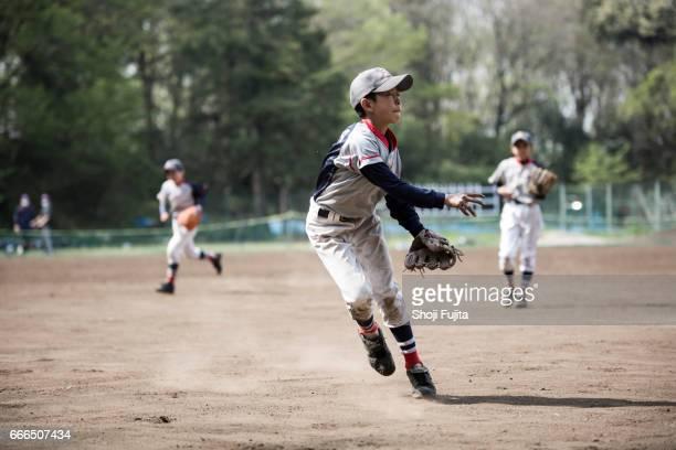 Youth Baseball Players,playing game,throwing