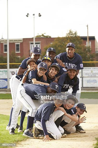 SportsKid of the Year Portrait of Taney Youth Association pitcher Mo'ne Davis posing with teammates during photo shoot at Marian Anderson Recreation...