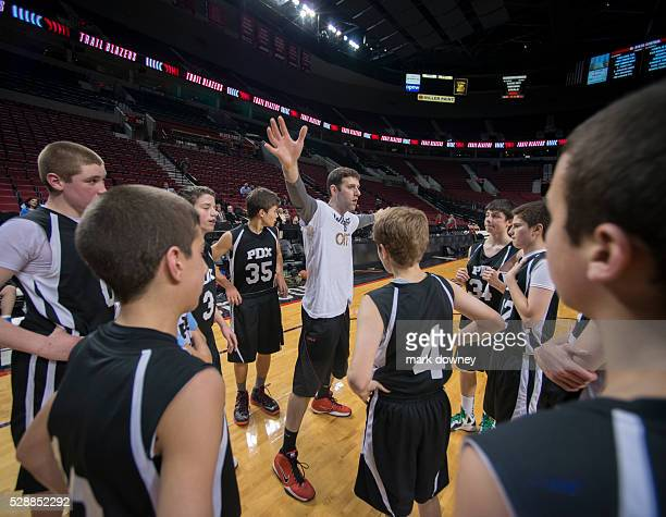 PDX Youth Basketball Tean receives instructions from Coach at Rose Garden