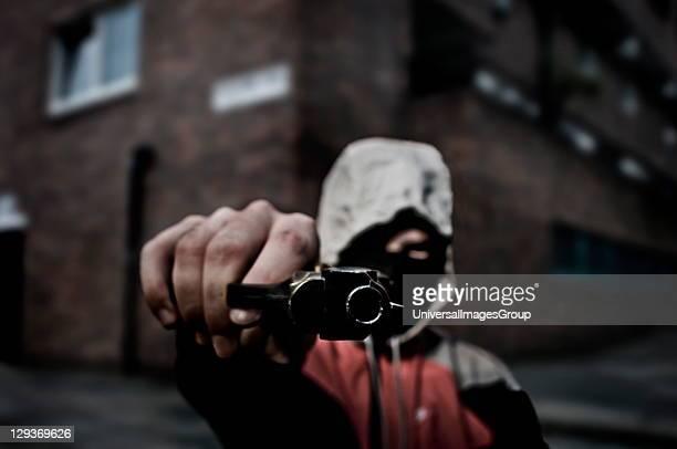 Youth brandishing a gun London 2008